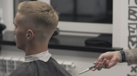 Barber takes scissors in slow motion