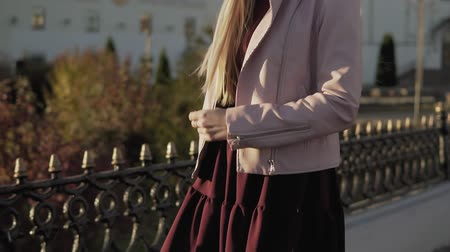 Beautiful blonde woman walking in city in slow motion