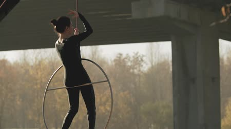 hoop : Flexible brunette with bare feet hanging in ring for aerial acrobatics in slo-mo Stock Footage