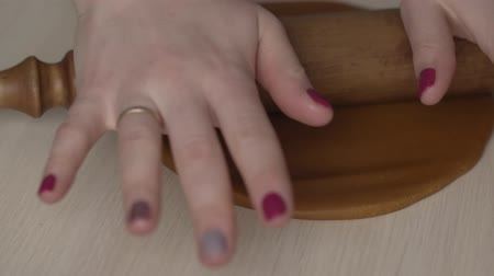 rolling pin : Female hands roll dough with rolling pin for christmas cookies on white table Stock Footage