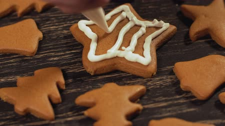 garnishing : Decoration of Christmas cookies. Close up garnishing homemade gingerbread star