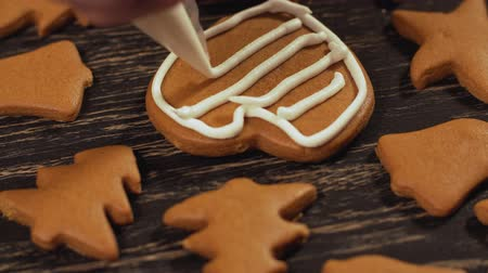 garnishing : Close up garnishing homemade gingerbread heart. Family culinary concept Stock Footage