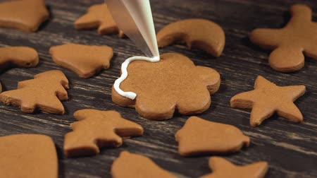 garnishing : Decoration of Christmas cookies. Close up garnishing homemade gingerbread flower