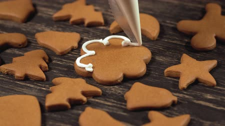 garnishing : Close up garnishing homemade gingerbread flower. Family culinary concept Stock Footage