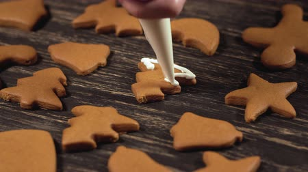 garnishing : Decoration of Christmas cookies. Close up garnishing gingerbread christmas tree