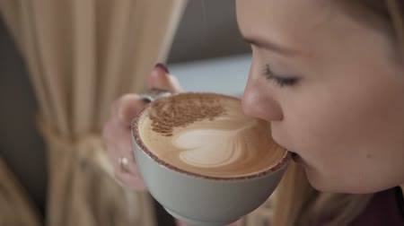 to be alone : Cute woman with cup of flavored coffee sitting in coffee shop Stock Footage