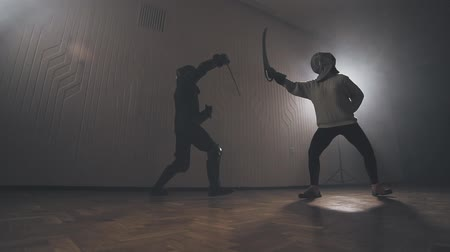 legionary : Warriors are fighting during sword battle indoors in slow motion. Stock Footage