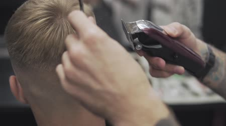 shaver : Male haircut with electric razor. Close up of man hairdressing with electric shaver. Styling with electric trimmer. Stock Footage