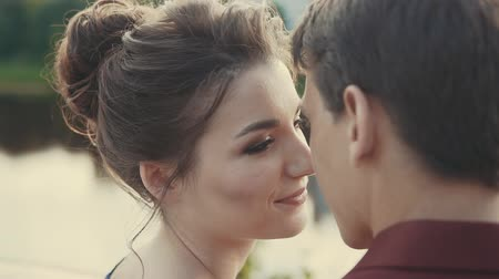 parte : Beautiful young couple enjoying intimate moment. Lovely touching noses. Sensual moment of love at sunset. Close up view. Valentines Day concept Stock Footage