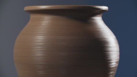 oficina : Clay jug spinning in slow motion. Handmade and craft concept.