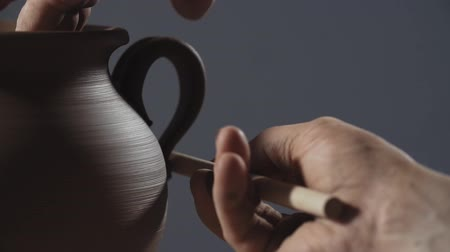 potter wheel : Man hands making clay product. Potter make jug handle from clay in slow motion. Close up of potters work. Stock Footage
