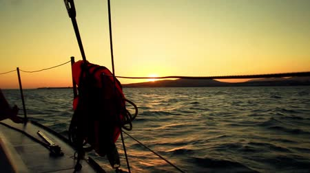 żaglówka : sunset from a yacht board - sailing and yacht details in the sea