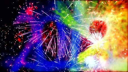 feliz ano novo : Dynamic 2018 New Year date fireworks design over a night sky - loopable animation
