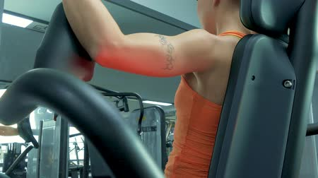 apparatus : Athletic young woman working out on a fitness exercise equipment at the gym. Health, sport and workout concept - 4K stock footage video