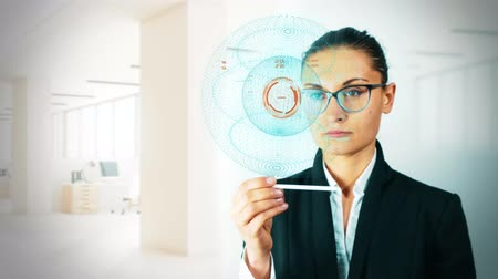Businesswoman working on holographic interface. concept of futuristic - 4K stock footage Stock Footage