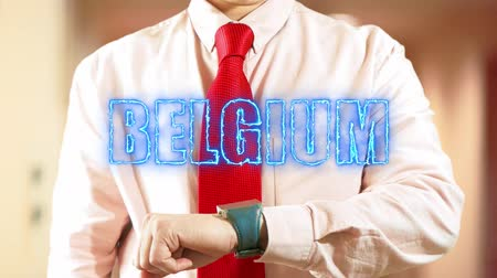 widgets : Belgium. Businessman chooses country on hologram clock on light background. Visual screen. Futuristic Interface 4K stock footage Stock Footage
