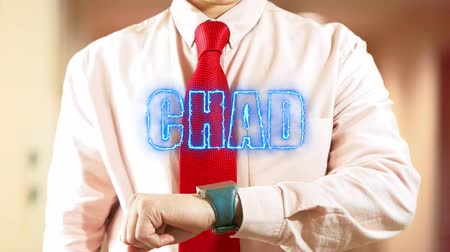 widgets : Chad. Businessman operating a smart device chooses а country in light office. Concept: business trip,hologram, technology, augmented reality, future, travel 4k footage clip