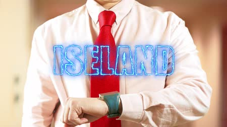 nomeação : Iseland. Businessman Working on Holographic Interface. Concept: business trip,hologram, technology, augmented reality and future 4k footage clip Stock Footage