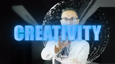 образность : Creativity. Woman touching a visual screen on dark background. Hologramic Technology. Augmented reality. Concept of futuristic 4k footage