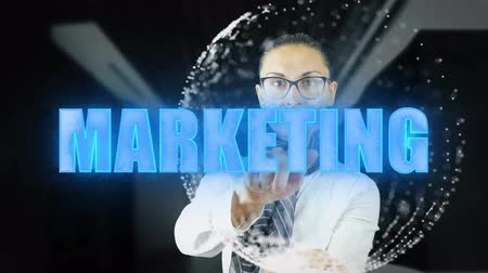 образность : Marketing. Businesswoman working on holographic interfaceon dark background . Concept of futuristic. 4k footage video