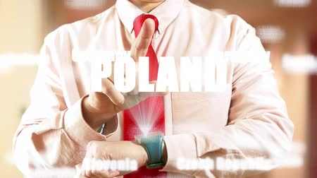 widgets : Poland. Businessman operating a smart device on light background. Concept: business trip,hologram, technology, augmented reality, future, travel 4K stock footage Stock Footage