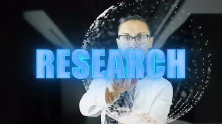 образность : Research. Woman touching a visual screen on dark background. Hologramic Technology. Augmented reality. Concept of futuristic 4k footage Стоковые видеозаписи