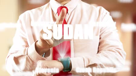 widgets : Sudan. Businessman chooses country on hologram clock on light background. Concept: business trip,hologram, technology, augmented reality, future, travel 4K stock footage