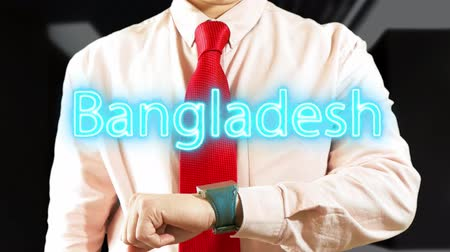 widgets : Bangladesh. Businessman operating a smart device on dark background. Concept: business trip,hologram, technology, augmented reality, future, travel 4k footage clip
