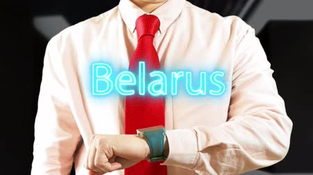 nomeação : Belarus. Man Working on Holographic Interface on dark background. Visual Screen 4K stock footage Stock Footage
