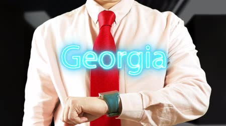 Georgia. Businessman Working on Holographic Interface. Concept: business trip,hologram, technology, augmented reality and future 4K stock footage Stock Footage
