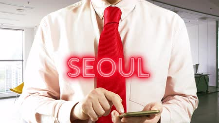 SEOUL Best Travel Offers with hologram businessman concept - 4K stock footage
