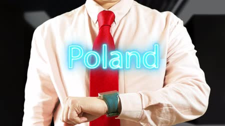 Poland. Businessman operating a smart device on dark background. Concept: business trip,hologram, technology, augmented reality, future, travel 4K stock footage