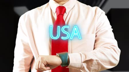 widgets : USA. Man working with hologram clock on dark background. Futuristic concept. Augmented reality 4K stock footage