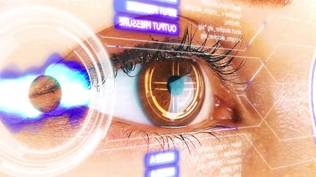 vizyon : Close up to womans eyeball with futuristic system. Futuristic vision of reality and concept of cyber technology 4k footage