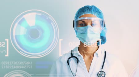 cardiologista : Female doctor wearing mask analyzing futuristic graphical implementation on white background. Concept: futuristic medicine, medical holography, futuristic science 4k footage Stock Footage