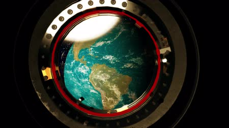 View from a porthole of space station the Earth.