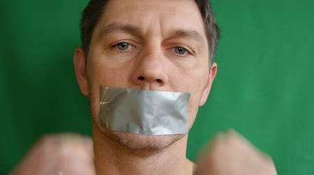 totalitarianism : Man with taped mouth. Stock Footage