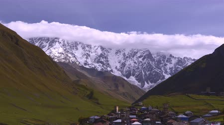 rüzgârla oluşan kar yığını : Majestic clouds mountain landscape at the foot of  Mt. Ushba. Upper Svaneti, Georgia,