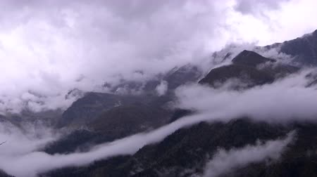 time lapse clouds : Storm clouds moving among the mountain peaks.
