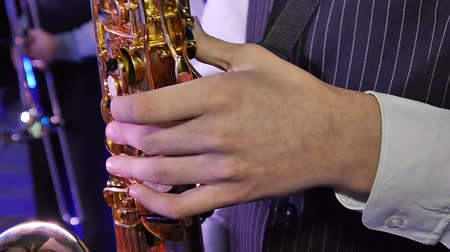 flutist : Musician is playing on saxophone Stock Footage