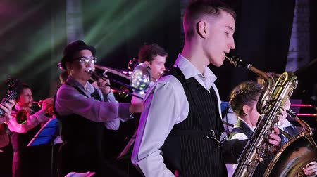 playing band : Childrens jazz band performs at the theater during a music festival