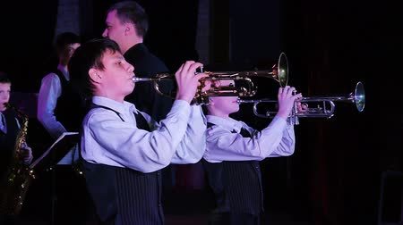 джаз : Childrens jazz band performs at the theater during a music festival