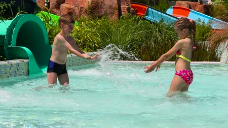 little : Happy children in the water park. Children playing in the pool Stock Footage