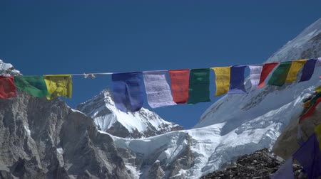 ima : Prayer flags against the background of the Everest. Himalayas. Nepal. 4K