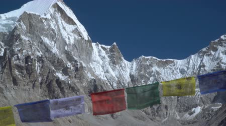 icefall : Prayer flags against the background of the Everest. Himalayas. Nepal. 4K