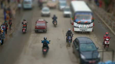 tilt shift : People, cars, motorbikes and rickshaws on the street. The traffic on on the streets in Kathmandu, Nepal. Time-lapse. Titl-shift