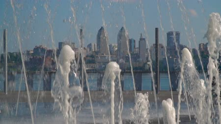squirting : Fountain on the background of city buildings. Slow motion