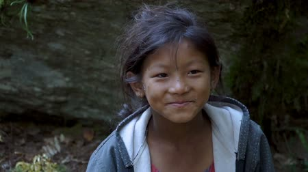 tibet tourism : Portrait of a smiling Nepalese girl