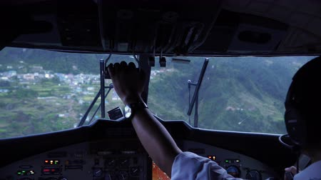 aircraft cabin : Landing aircraft at Tenzing-Hillary Airport in Lukla. Cockpit view of plane landing. The airport in Lukla is the most dangerous airport in the world.