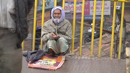 evsiz : A homeless person asks for money from passersby. Nepal. Kathmandu